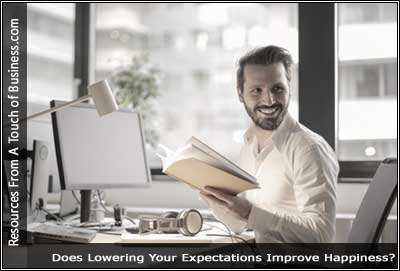 Image of a smiling man sitting at a desk