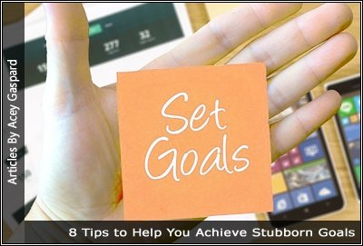 Imgage of a hand holding a s sticky note saying set goals