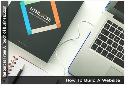 Image of a Html & CSS book next to a laptop