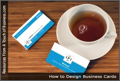 Image of business cards next to a cup of tea on a tabel